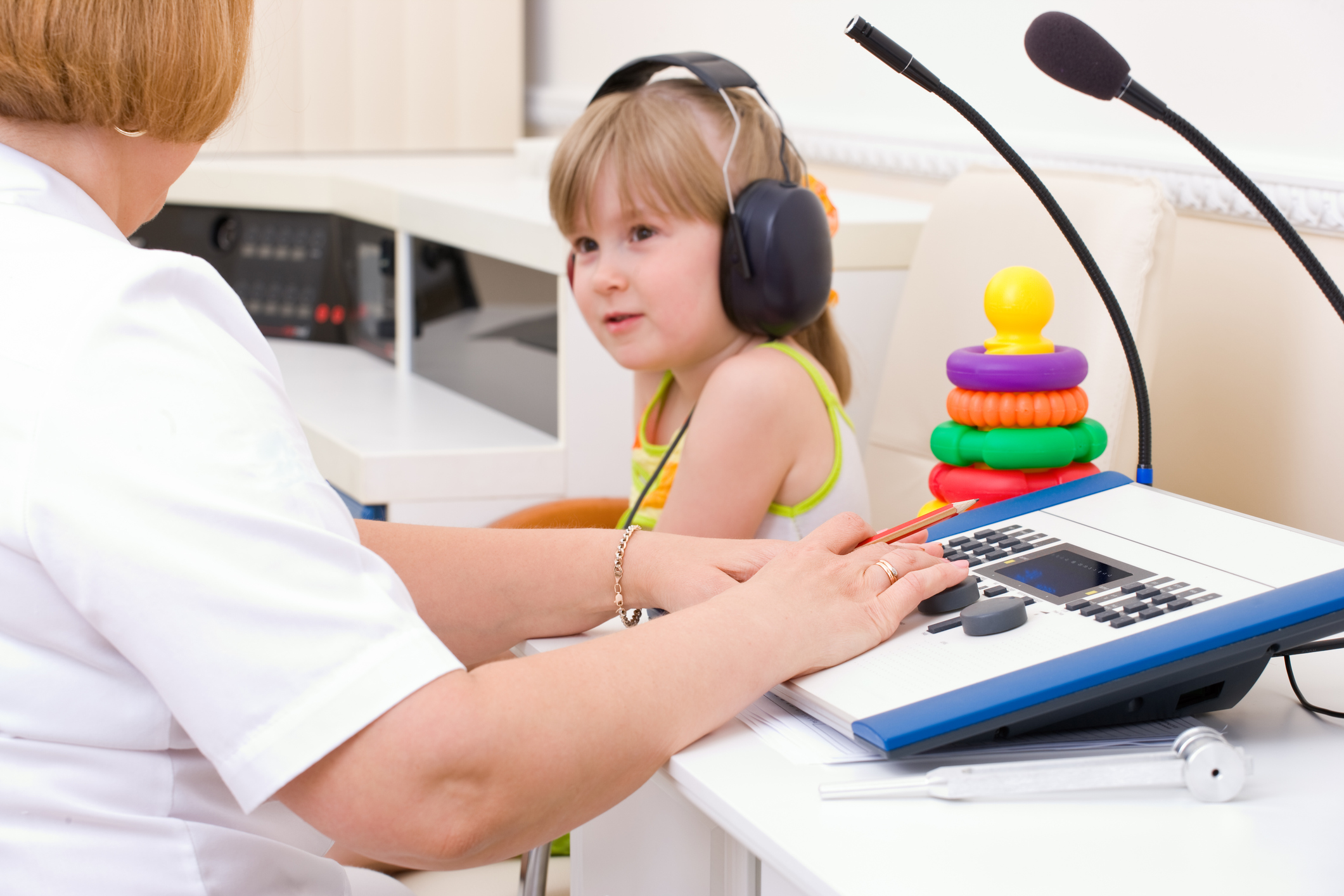Doctor audiologist testing girl