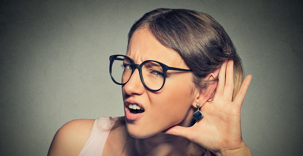 nosy woman hand to ear gesture or hard to hear