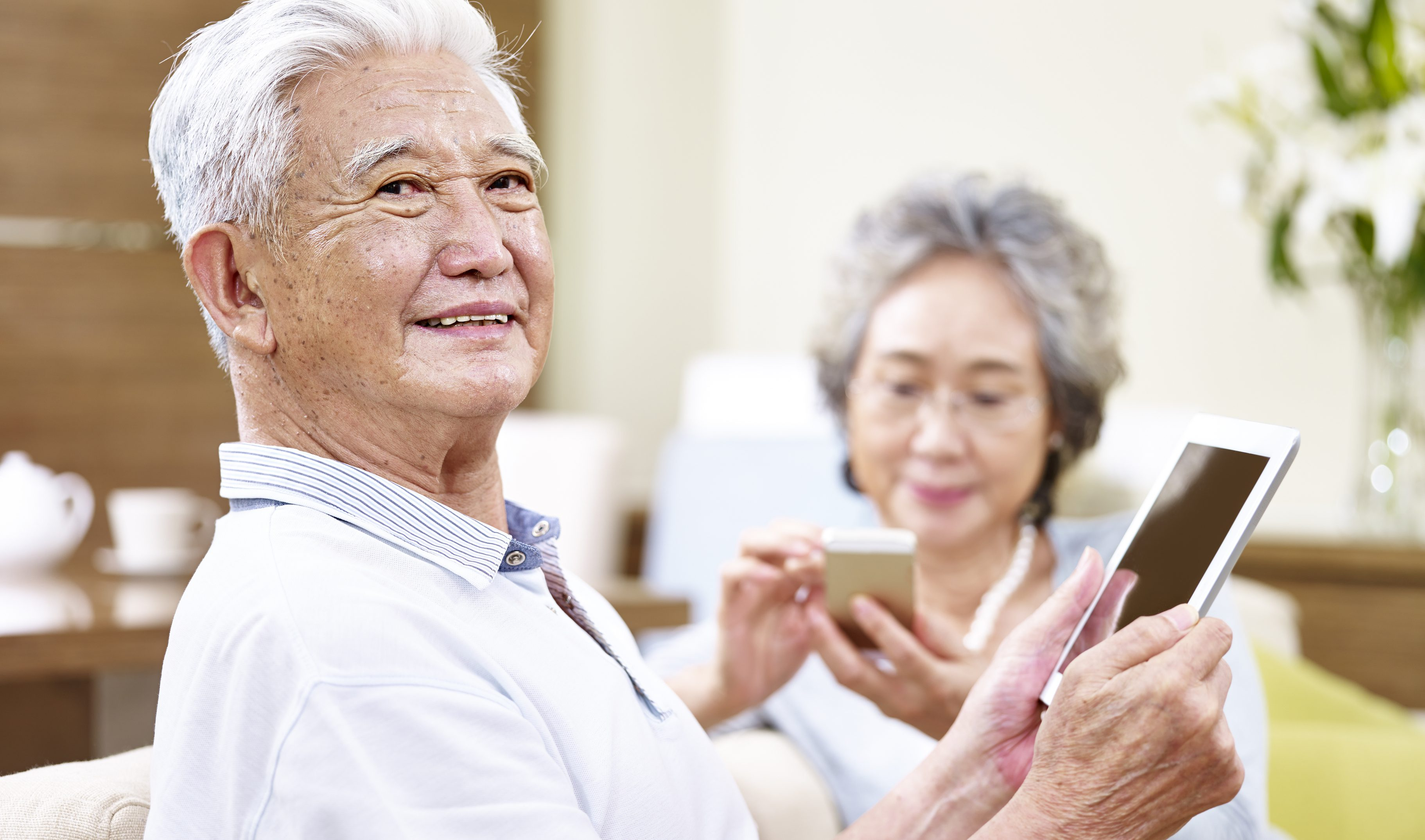senior asian couple enjoying modern technology