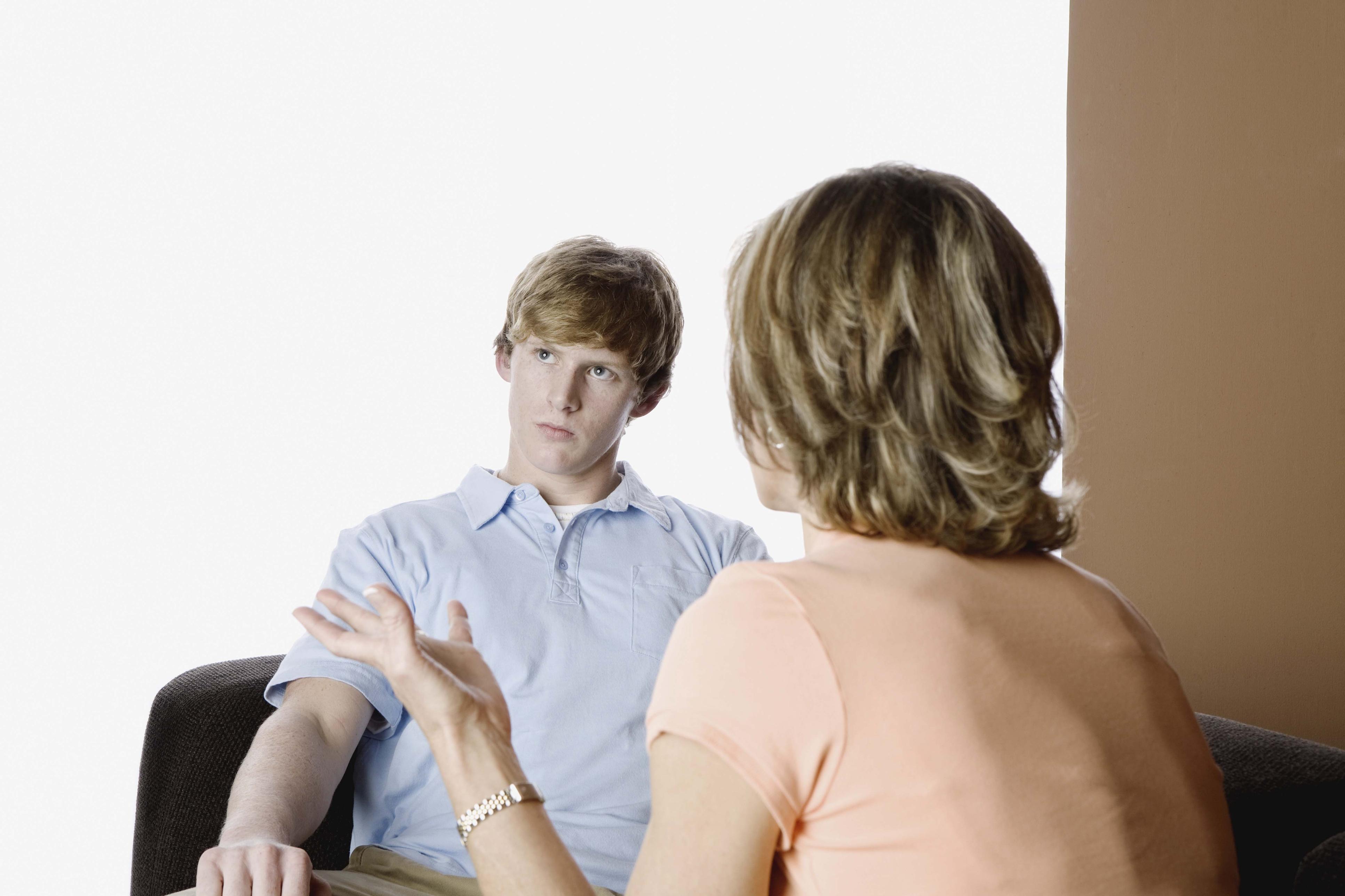 Teenage boy ignoring mother