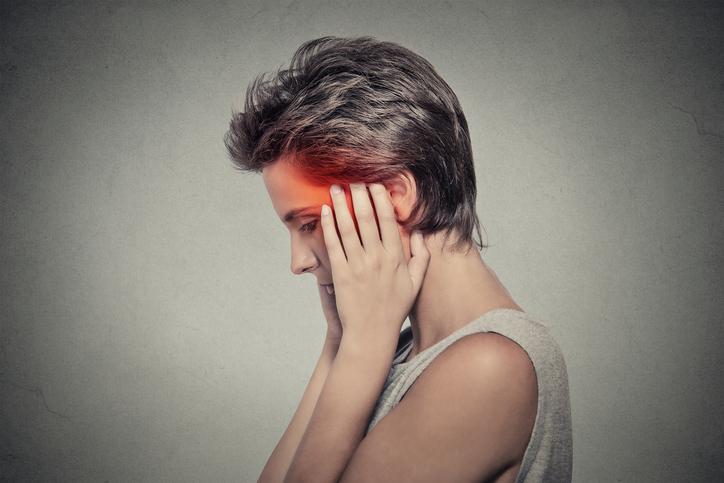 sick woman having ear pain headache. Tinnitus.